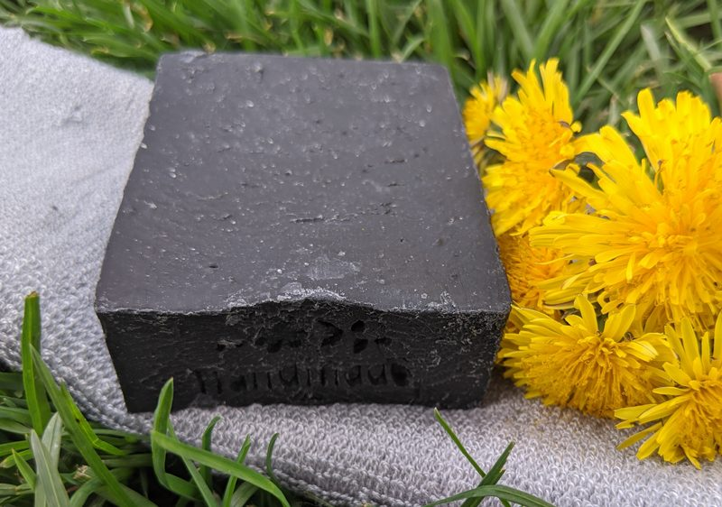 best-selling-products-charcoal-soap-with-yellow-flowers