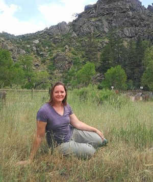 Founder Marisa May relaxing in the mountains.