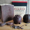 handmade-chocolate-soap-bar-in-front-of-Nuance-Chocolate-bar-with-cocoa-beans-and-two-truffles-at-side